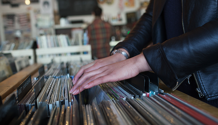 Person selecting vinyls