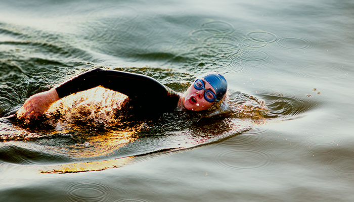 Woman swimming in open water